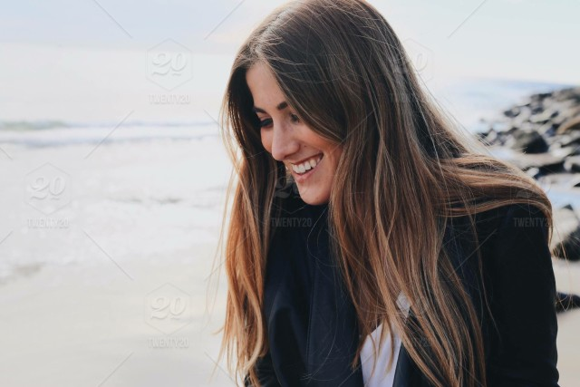 stock-photo-portrait-beach-california-female-hair-girl-selfie-smile-person-30ba5aca-ee0b-480e-8b71-d0bbb4f420e2